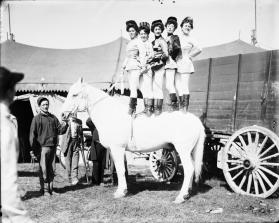 Dallie Julian Ledgett and Four Other Equestrians Standing on Horseback