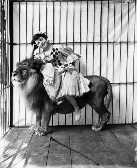 Portrait of Madame Scheel atop a lion