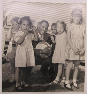 African American Man with Children Posing with Beach Ball