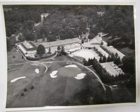 Aerial View of a Club with an Outdoor Swimming Pool, Tennis Courts, and a Golf Course