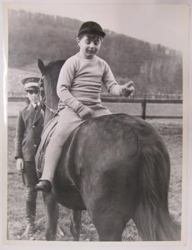 Boy Seated Backwards on Horse