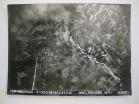 Aerial view of the bombing of marshalling yards in Holzwickede, Germany, March 23, 1945, by the  486th Bombardment Group