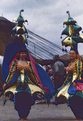 2 Female Performers in Green and Blue Costumes
