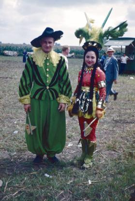 2 performers in green and red costumes in BY
