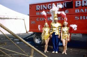 2 ladies and 1 man in gold costumes