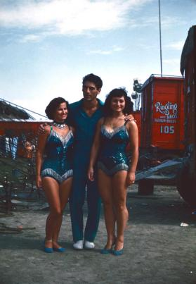 2 ladies and 1 man in blue costumes in BY